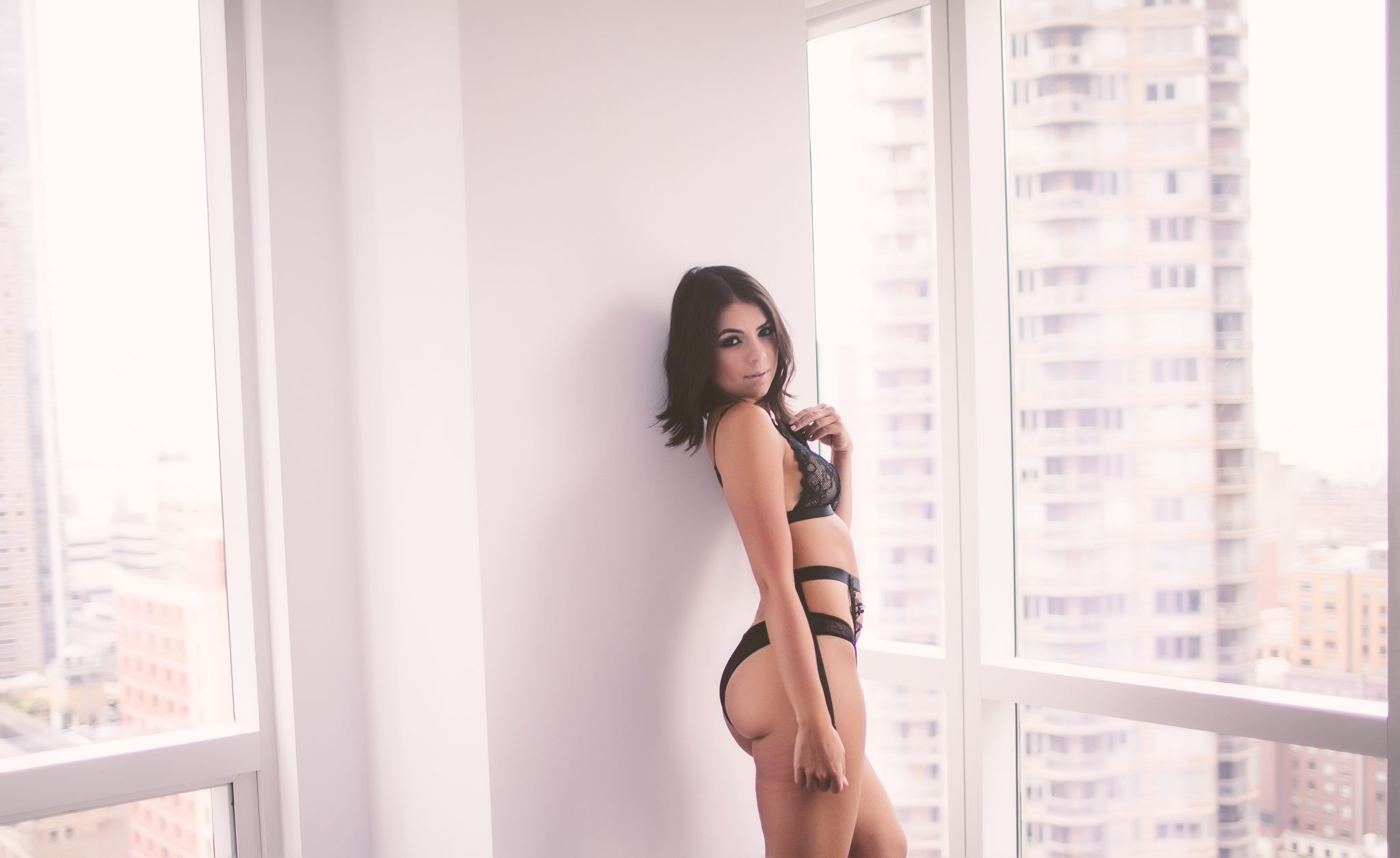 Boudoir model posing for a photo session in NYC
