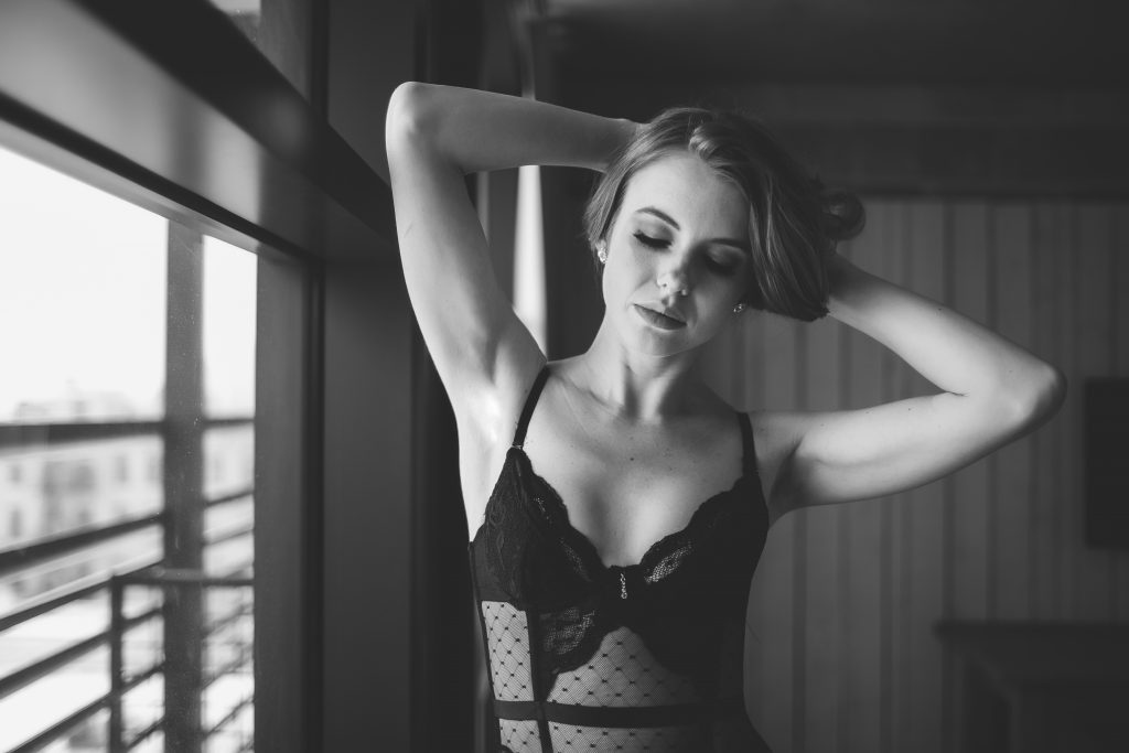 A woman poses in a luxury NY boudoir shoot