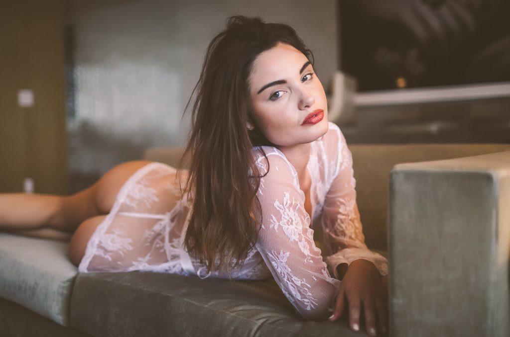 Beautiful model wearing white lace lingiere