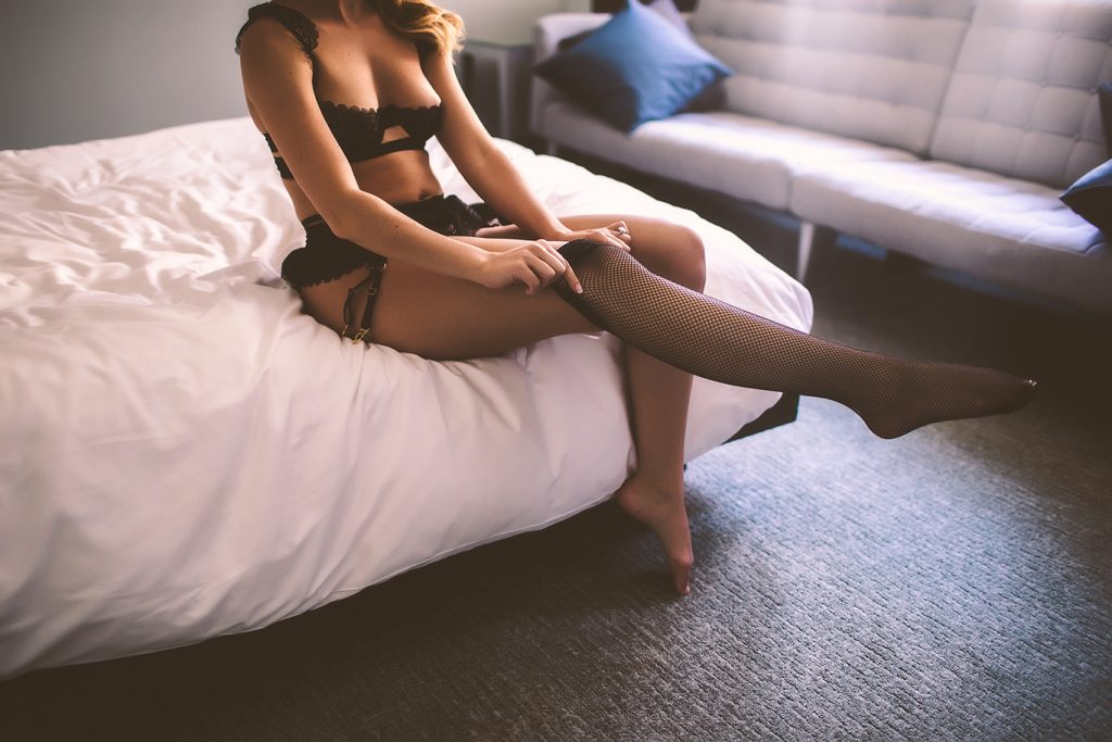 A wedding boudoir photography session in a NYC hotel room
