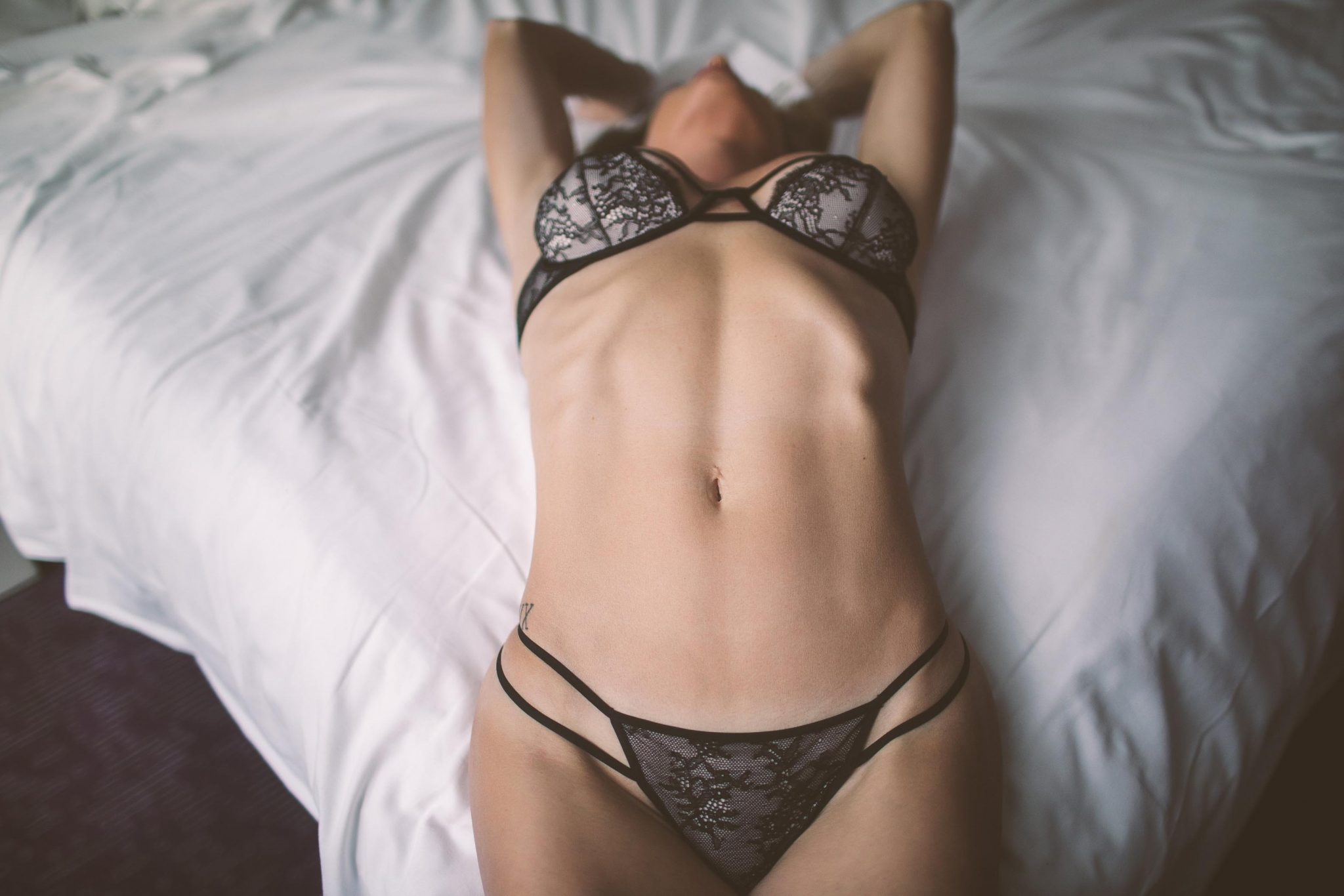 Model wearing lingerie at a boudoir shoot