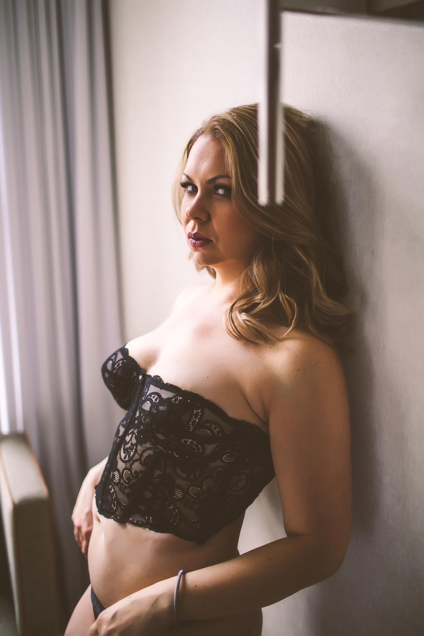 A model posing in lace lingerie