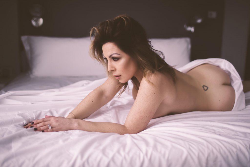 a woman posing for a boudoir shoot