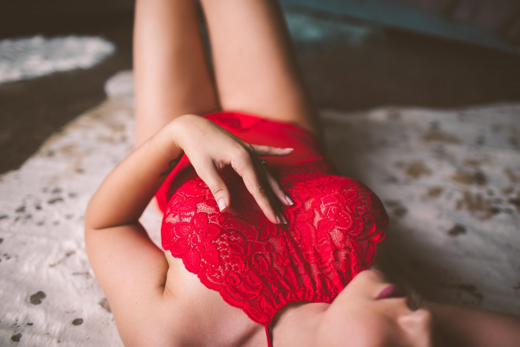 a woman posing in red lingerie