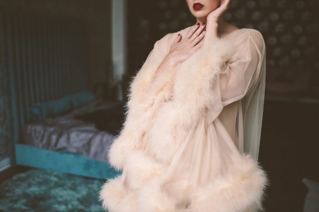 a sexy woman posing in a beautiful robe