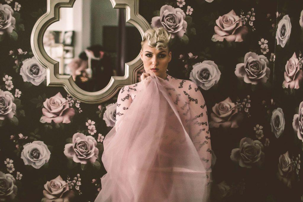 a woman posing in a brooklyn photo studio