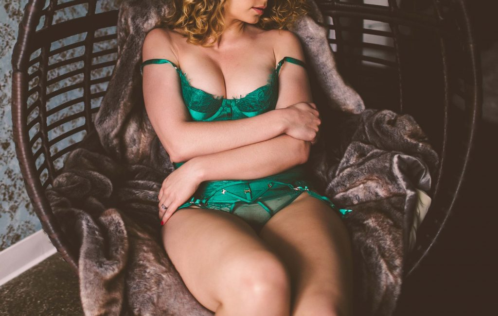 stunning model wearing green lingerie